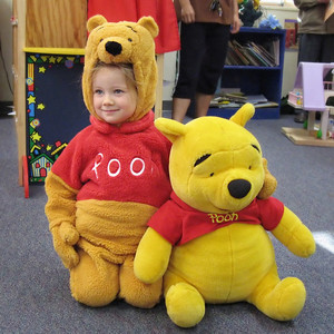 10/26 - Lili's costume on the Preschool's Halloween party. The toy Pooh Bear belongs to the scool, the cute one belongs to us!