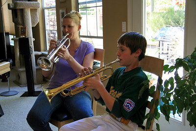 Katie tutors Joey on the trumpet. He had a blast (pun intended) and learned a lot.