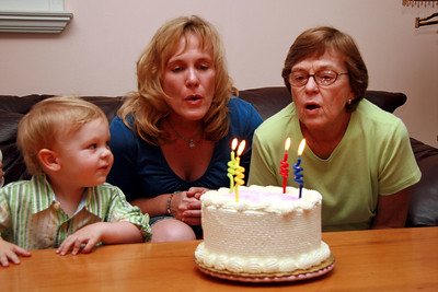 Sara and her mom, Barbara, share a birthday...they enlist Carter's help with the candles.