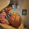 Olivia Gill sits in her high chair in the kitchen at home in Hallsville, Missouri on January 29, 2006.