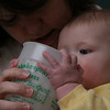 Megan helps Olivia Gill drink from a Shakespear's Pizza cup in the livingroom at hom ein Hallsville, Missouri on January 28, 2006.