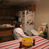 Olivia Gill sits in her high chair and plays with a washcloth and also eats dinner in the kitchen in Hallsville, Missouri on January 28, 2006.