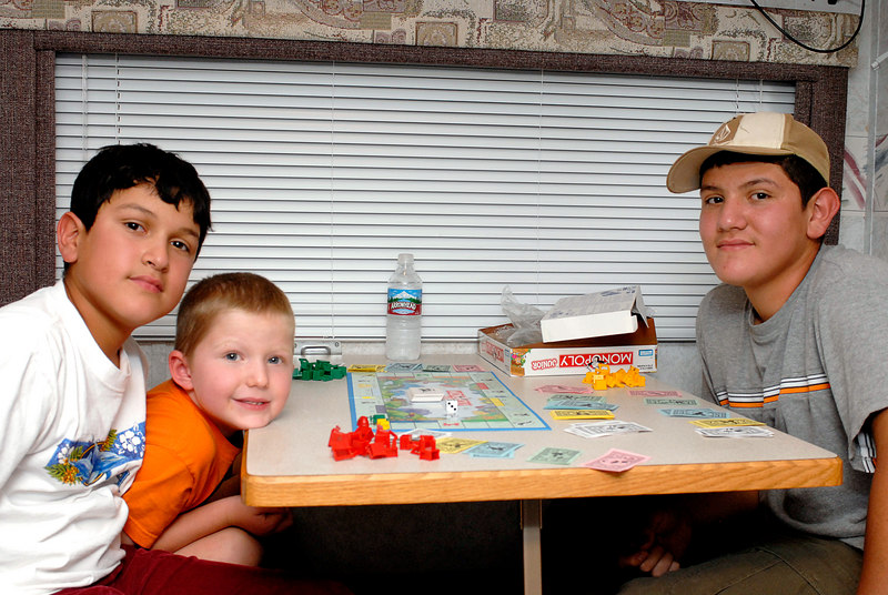 (7.29.2006 -- Fool's Hollow)  Connor, Sammy and Isaac relaxing over a game of Monopoly after a hard day on the lake.