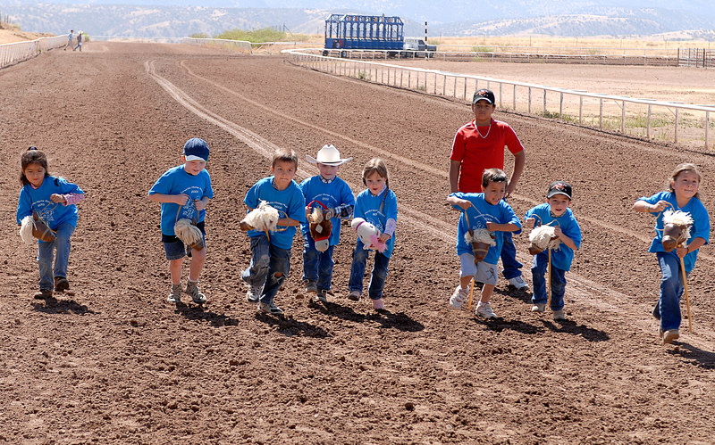 (5.6.2006 -- Sonoita, AZ)  Connor off to a slow start in the stick horse race at the Sonoita horse races.