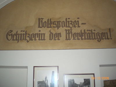 """Nifty slogan on the wall of the restaurant that has been created out of the old Nikolai School.    (""""People's police: protector of those active in work!""""). Hhhmmm ."""