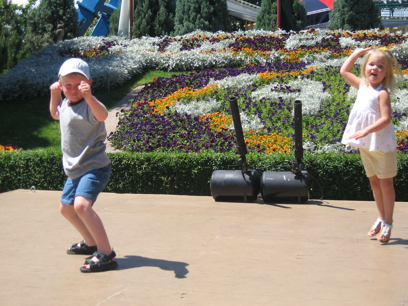 Logan, Todd's nephew, and Tori dancing on stage at the amusement park in Denver, CO.