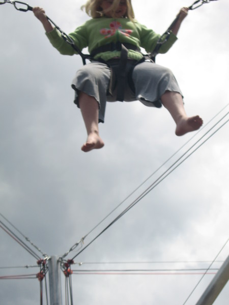 Kenzie jumping high on the trampoline bungee jump activity in Breckenridge, CO.