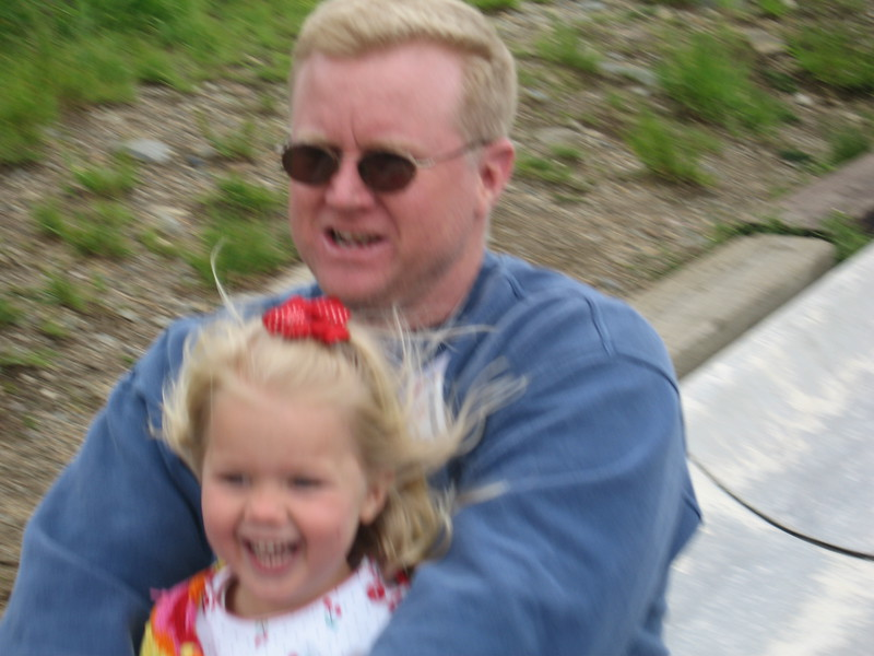 Daddy and Tori riding fast on the alpine slide at Peak 8 in Breckenridge, CO.