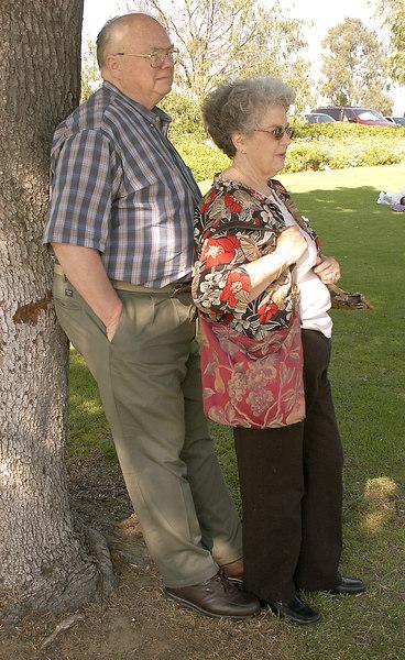 May 29, 2005 -- Grandpa holding up a tree in Balboa Park and Grandma holding up Grandpa.