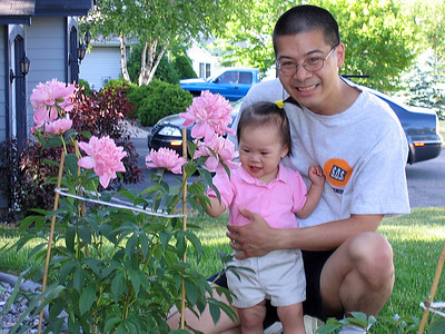 jun 3, 06 admiring the peonies.jpg