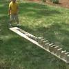 2007-5-28 - Ian knocking over wood slabs in backyard
