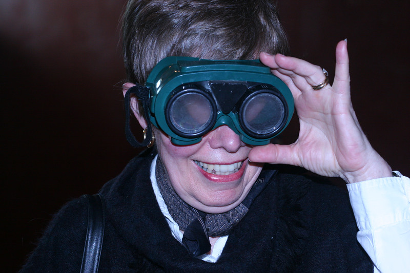 Mom, wearing goggles at the Cranbrook Science Museum