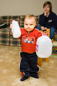 K.C. is fascinated with things that rattle.  Therefore, we put his spoons in empty milk jugs for his entertainment.  One of his favorite things this month is walking while rattling the milk jugs.