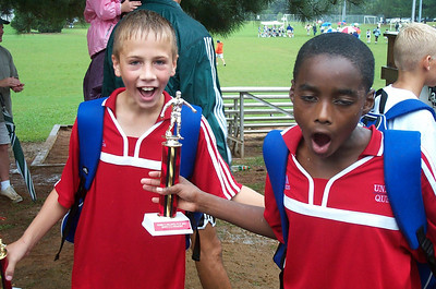 ...and here they are doing the same thing at the U12 award ceremony.