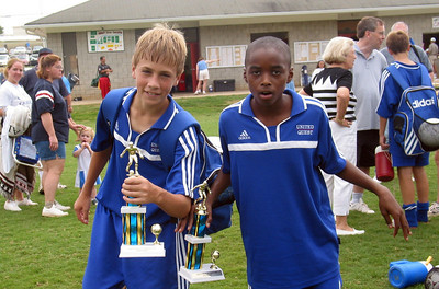 Thomas and Warren striking the same pose at the U13 awards ceremony...