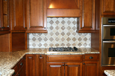 Here's the new gas cooktop with Frank's Tuscan checkerboard backsplash design.