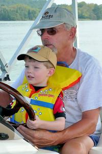 Gavin steering the boat