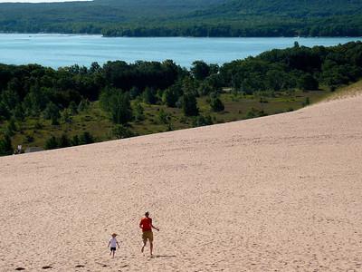 Gavin and Tim running down the dunes Sleeping Bear Sand Dunes