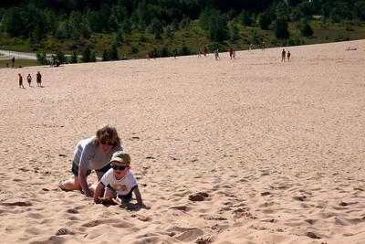 Gavin and Kathy crawling up Sleeping Bear Sand Dunes