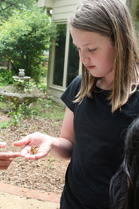 Amaya Holds a Butterfly