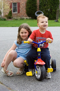 "Sarah poses with K.C. on his new ""zoomer."""