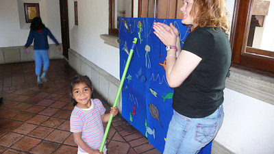 esperanza fishes for presents with chrissy's help