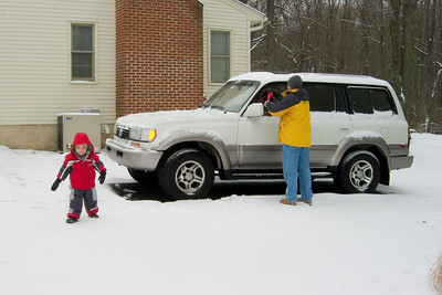 K.C. supervises as Dad clears off the Lexus.