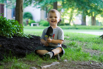 Since K.C. saw Dad digging in the dirt, he's been fascinated with finding worms. Ever since then he's been on a worm finding mission by digging through the mulch.