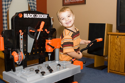 K.C. proudly displays his new tool bench that he received for his 3rd birthday.