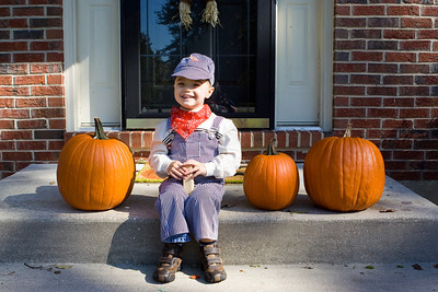K.C. is dressed as a train engineer for Halloween.