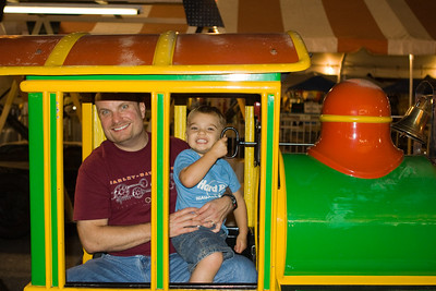 Riding the train with Dad at the Polish festival.  KC liked ringing the bell.