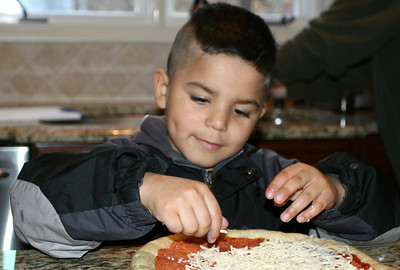 Berto Making Pizza