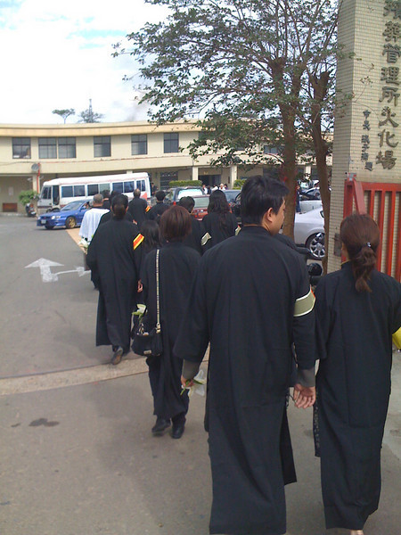 2008 11 26 Wed - Funeral family in black robes & colored armbands walking to crematorium