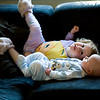 Beverly and Quin fooling around on the couch