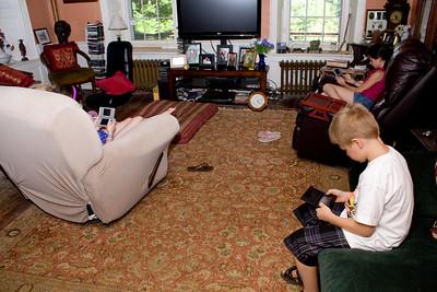 Alana, Cassandra and Nicholas play their PSPs