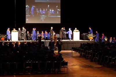 David accepts his diploma