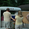 Everyone helps Bobby get his wares out.<br /> We can't eat until he cooks the burgers and hot dogs.