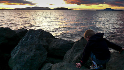 Gavin climbing on rocks