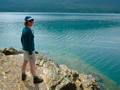 Kathy deciding whether or not to go for a swim.  Lake McDonald, GNP