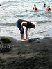 Syl looking at the black sand