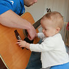 11/3/09 helping papa to play a guitar