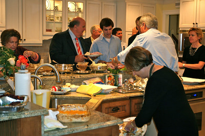 Hustle and bustle in the kitchen as Thanksgiving dinner is served