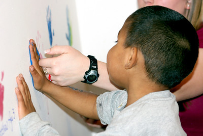 Alex puts his handprint on the wall
