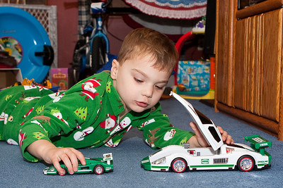 K.C. plays with is new Hess cars.