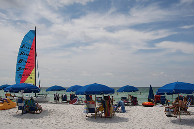 Our view again, but with the rental sailboat. When we went down to the water we would go through beside the sailboat. The beach didn't seem overly crowded, but the front row of umbrellas were close together and you felt you were going through someone's private space no matter where you decided to go through.