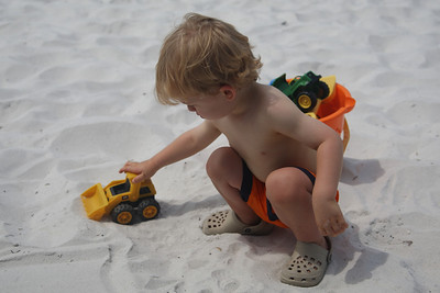 I was afraid he would hate the sand, but he loved it! He's been playing in dirt a lot lately, though, so he was probably a little more used to the feel than I expected.