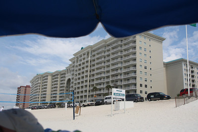 One of the buildings of the complex where we stayed...and the edge of our beach umbrella. The archway in the middle of the front building is where the indoor-outdoor pool is located where we would go to swim on Thursday.