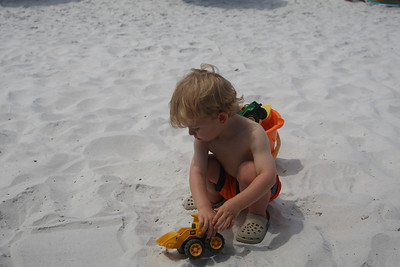 Playing in the Gulf sand for the first time! He loved playing with the front-end loader. He had a few other trucks, but I'm not sure he played with them at all. He loved scooping up the sand and dumping it.