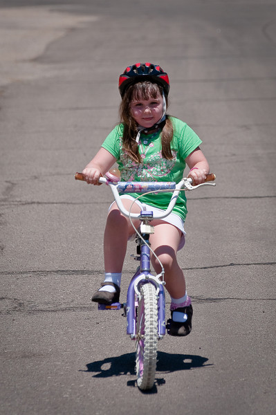 Father's Day 2009 -- Claire riding her bike without training wheels for the first time ever!!!