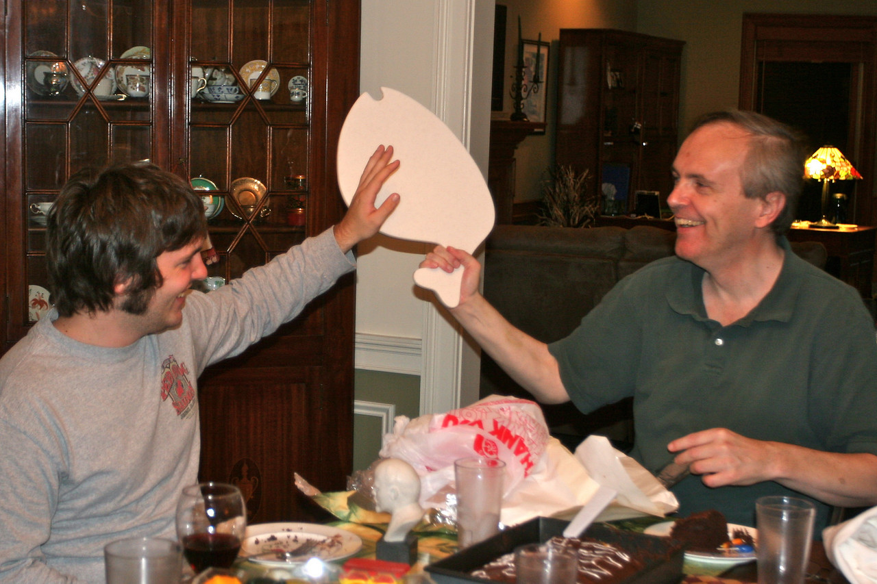Frank and Drew duel with the whale cutting board